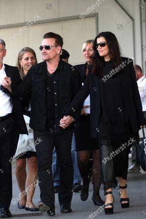 Bono and wife Ali Hewson arrive at the Tessera Airport