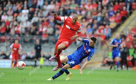 Rochdale's Scott Tanser tackles Leyton Orient's Shaun Batt