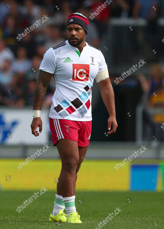 Stock Photo of Despite a warm day in the South West, Jordan Turner-Hall of Harlequins warms up wearing a bobble hat