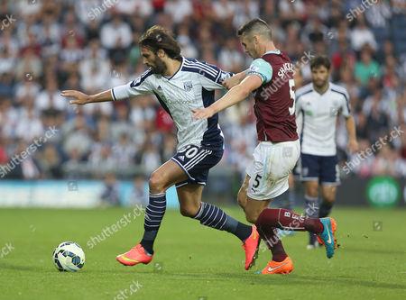 West Bromwich Albion's Georgios Samaras battles with Burnley's Jason Shackell