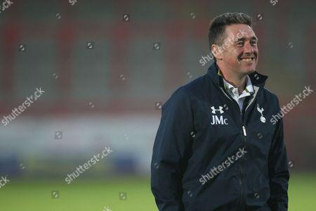 John McDermott Coach of Tottenham Hotspurs smiles