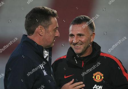 Manchester United Coach Warren Joyce and John McDermott Coach of Tottenham Hotspur