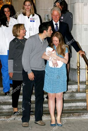 Hillary Clinton, Bill Clinton, Marc Mezvinsky and Chelsea Clinton with daughter Charlotte Clinton Mezvinsky