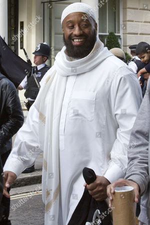 Abu Izzadeen, born Trevor Brooks on a 'Muslims Against Crusades' protest to disrupt a one minute silence outside the US embassy on the tenth anniversary of the 9/11 attacks