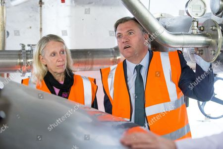 Liz McInnes and Ed Balls on a tour of the JW Lees Brewery factory