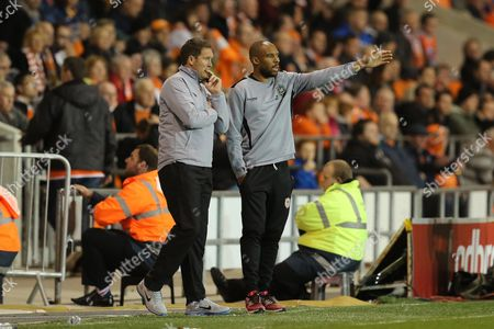 Cardiff City caretaker managers Scott Young and Danny Gabbidon look on from the technical area