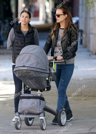 Olivia Wilde (R) and friend with baby Otis Sudeikis
