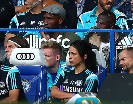 Injured Chelsea duo Didier Drogba and Ramires watch from behind the substitutes bench