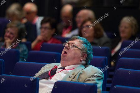 A delegate sleeps as Steve Webb speaks