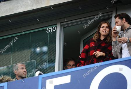 Chelsea owner Roman Abramovich looks towards girlfriend Dasha Zhukova