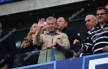 Chelses owner Roman Abramovich waves to fans at full time after a 2-0 win