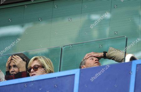 Chelsea owner Roman Abramovich rues a missed chance alongside girlfriend Daria Zhukova