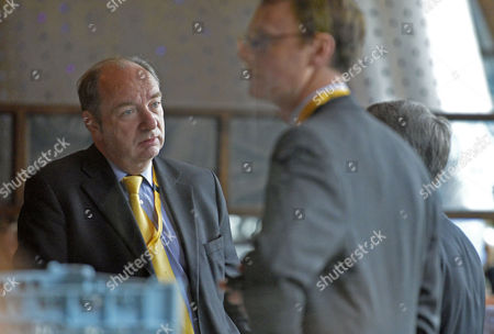 Parliamentary Under secretary Of State For Transport Norman Baker MP (l) Chats At Breakfast In The Crowne Plaza Hotel. Liberal Democrat Party Conference At The Scottish Exhibition And Conference Centre In Glasgow Scotland.  17.9.13.