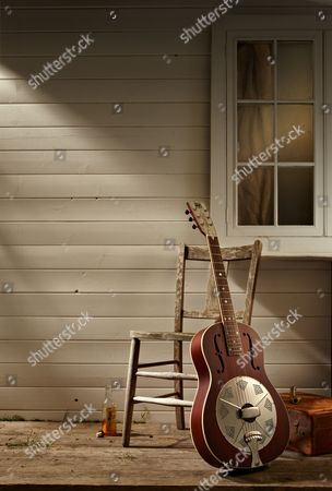 A National Reso-phonic M2 Mahogany Resonator Guitar Photographed On A Deep South-style Front Porch For A Feature On Slide Guitar And Blues Music
