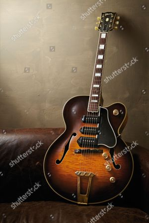 A 1951 Gibson Es-5 Electric Guitar Photographed On A Leather Sofa