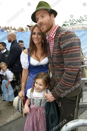 Xabi Alonso with wife Nagore Aranburu and daughter Ane