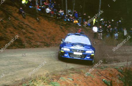 Stock Image of Richard Burns cornering on Network Q rally 1999 in Subaru Impreza