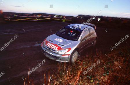 Richard Burns driving Peugeot 206 WRC on 2002 Network Q Rally