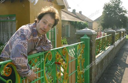 HENRY DAGG WHO SPENT £60,000 TURNING HIS GARDEN FENCE INTO A GIANT GLOCKENSPIEL