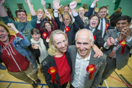 The count at the Heywood and Middleton by-election - Labour candidate Liz McInnes (front left) with her partner Steve Duxbury, cheered by her team behind, after Labour's victory is declared.