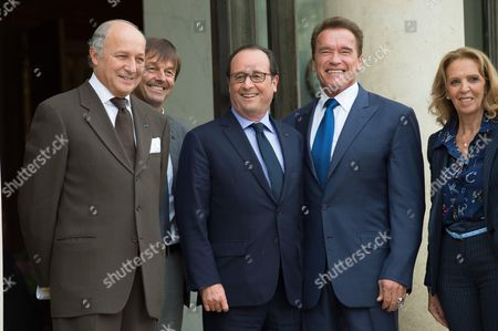 French Foreign Minister Laurent Fabius, Environmental activist Nicolas Hulot and Ile-de-France regional council Michele Sabban pose next to US actor and former governor of California Arnold Schwarzenegger and French President Francois Hollande