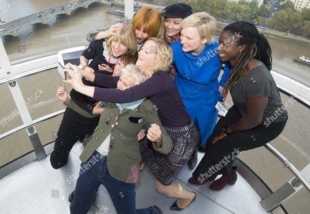 Stock Picture of Julie Walters, Mary Portas, Natasha McElhone, Christina Ohuruogu, Stella Creasy MP, Rachel Johnson, Cathy Newman and Kathy Lette with Dunraven schoolgirls posing for selfies