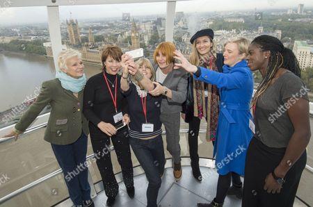 Julie Walters, Mary Portas, Natasha McElhone, Christina Ohuruogu, Stella Creasy MP, Rachel Johnson, Cathy Newman and Kathy Lette with Dunraven schoolgirls posing for selfies