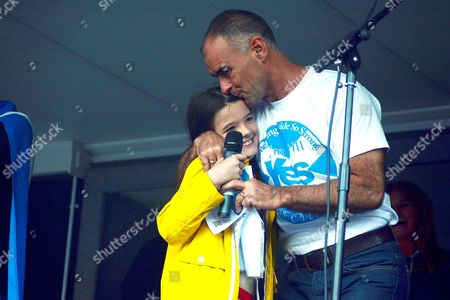 Tommy Sheridan kisses his daughter Gabrielle after her speech