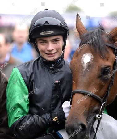 William Twiston-Davies and Krazy Paving after winning The Ladbrokes British Stallion Studs EBF Maiden Stakes @ Windsor Racecourse. Pic: Hugh Routledge 13.10.14