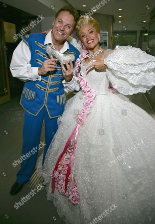 Brian Conley as Buttons and Kathryn Rooney as Cinderella