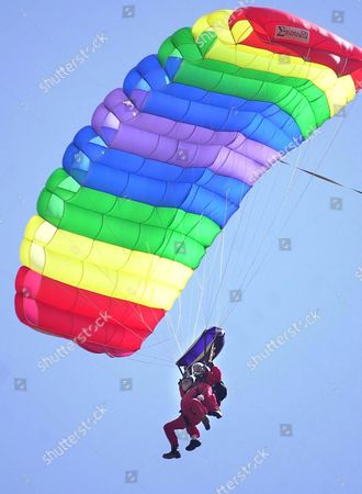 Lord Bath approaching touchdown after his leap from 13,000 feet with the Red Devils