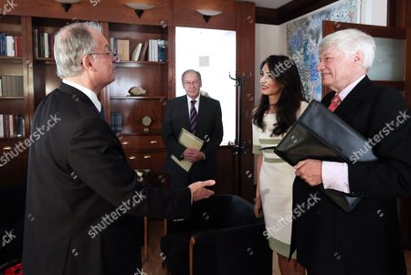 Amal Clooney (C) and Geoffrey Robertson (R) with Greek Culture Minister Kostas Tasoulas (L)
