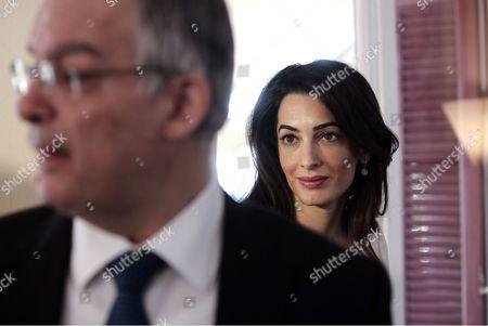 Amal Clooney (R) with Greek Culture Minister Kostas Tasoulas (L)