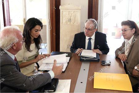 Amal Clooney (2nd L) with Greek Culture Minister Kostas Tasoulas (3rd L)