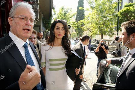 Amal Clooney (C) with Greek Culture Minister Kostas Tasoulas (L)