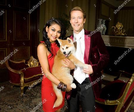Edward Davenport and Monthira Sanan-Ua with dog