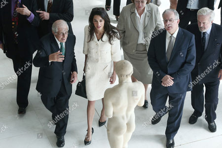 Amal Clooney with Greek minister for culture Kostas Tasoulas and Director of the New Acropolis Museum, archeology professor, Dimitrios Pantermalis