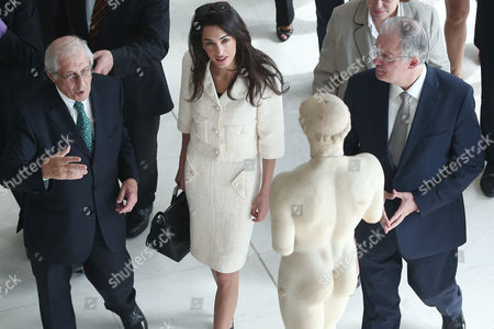 Stock Picture of Amal Clooney during a tour at the new Acropolis museum with Greek minister for culture Kostas Tasoulas and Director of the New Acropolis Museum, archeology professor, Dimitrios Pantermalis