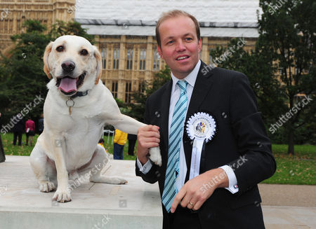Westminster Dog Of The Year In Victoria Tower Gardens Outside The House Of Lords. Mps Bring Their Dogs To Compete For Westminster Dog Of The Year Held By The Dog Trust. Pictured: David Burrowes Conservative Mp For Enfield Southgate And His Dog Cholmeley Who Went On To Place Third In The Competition.