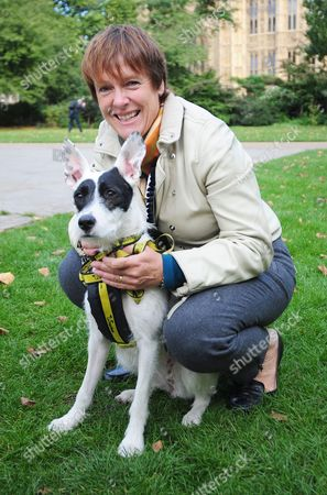 Westminster Dog Of The Year In Victoria Tower Gardens Outside The House Of Lords. Mps Bring Their Dogs To Compete For Westminster Dog Of The Year Held By The Dog Trust. Pictured: Caroline Spelman Conservative Mp For Meriden With Her Dog Harper.