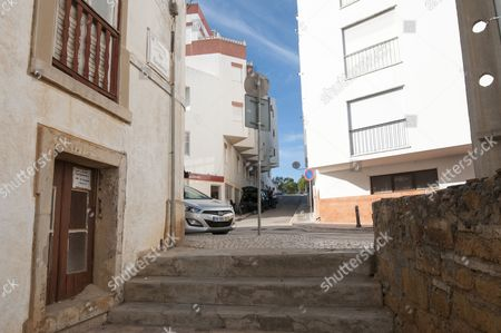 Editorial picture of Street In Praia Da Luz Where Irish Holiday Makers Martin Smith And His Wife Claim They Saw A Mystery Person With A Child About The Same Time As Madeleine Mccann Disappeared In May 2007. Picture David Parker 14.10.13 Reporter Neil Sears And Rebecca Ca