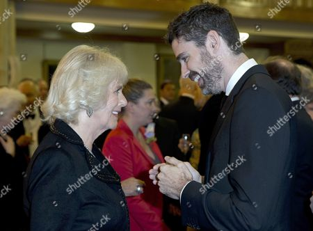 Camilla Duchess of Cornwall speaks to US author Joshua Ferris, who wrote 'To Rise Again at a Decent Hour', and is a nominee for the Man Booker for fiction 2014 at the Guildhall
