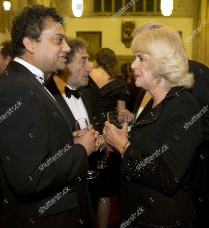 Stock Picture of Camilla Duchess of Cornwall speaks to British author Neel Mukherjee, who wrote The Lives of Others', and is a nominee for the Man Booker for fiction 2014
