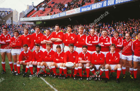Rugby Union - 1987 Five Nations Championship - Wales v England at Cardiff Arms Park -  Wales team -  Back (l-r): Adrian Hadley (sub), Jonathan Davies, Stuart Evans, Phil Davies, Jeff Whitefoot, Steve Sutton, Bob Norster, Paul Moriarty, Richie Collins (sub), Anthony Buchanan (sub), Malcolm Dacey (sub), Steve Davies (sub), Jonathan Griffiths (sub). Front: Mark Wyatt, Ieuan Evans, Kevin Hopkins, Robert Jones, David Pickering (captain), Billy James, Glen Webbe, John Devereux