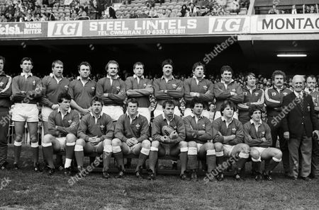 Rugby Union - 1985 Five Nations Championship - Wales v England at Cardiff Arms Park -  Wales team. Back (l-r): Mark Wyatt (sub; partly obscured), Phil Lewis, Stuart Evans, Jeff Whitefoot, Gareth Roberts, John Perkins, Robert Norster, Phil Davies, David Pickering, Malcolm Dacey (sub), Ian Stephens (sub), Bill Hardiman (Head Groundsman), Mike Richards (sub). Front: Adrian Hadley, Kevin Hopkins, Paul Thorburn, Terry Holmes (captain), Billy James, Robert Ackerman, Jonathan Davies.