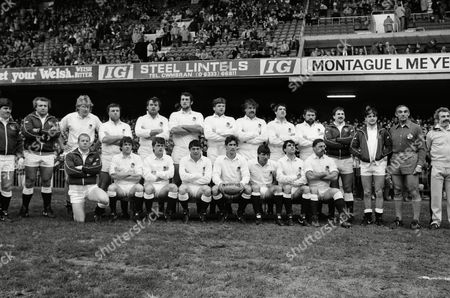Rugby Union - 1985 Five Nations Championship - Wales v England at Cardiff Arms Park -  England team - Back (l-r): Stuart Barnes (sub), Paul Rendall (sub), David Cooke, Gary Pearce, Jon Hall, Wade Dooley, John Orwin, Bob Hesford, Chris Martin, Austin Sheppard, Andy Simpson (sub), Huw Davies (sub), Francis Palmade (Referee - FFR), unknown reserve touch-judge. Front: Richard Hill (sub), Nigel Melville, Kevin Simms, Rory Underwood, Paul Dodge (captain), Rob Andrew, Simon Smith, Steve Brain.