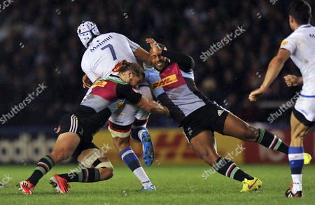 Stock Image of Chris Robshaw and Jordan Turner-Hall of Harlequins tackle William Whetton of Castres Olympique