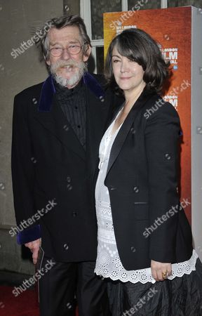 Stock Photo of John Hurt and Anwen Rees Meyers