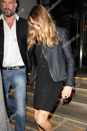 Editorial image of Cara Delevinge leaving the Corinthia hotel and arriving at Nobu Restaurant, London, Britain - 18 Oct 2014
