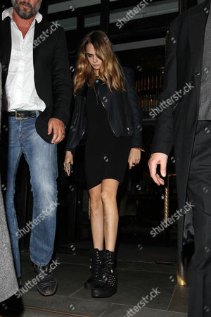 Editorial photo of Cara Delevinge leaving the Corinthia hotel and arriving at Nobu Restaurant, London, Britain - 18 Oct 2014